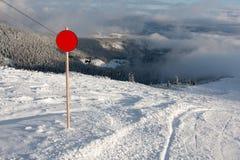 Red round sign on ski resort Royalty Free Stock Image