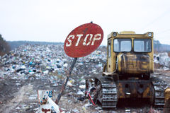 Red round stop sign, indicating that garbage at this dump has long denied. Landfill works. Lviv waste. The problem of  disposal. Stock Photos