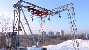 Red round wheel under snow rotated on metal elevator, winter, stock video footage