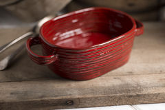 Red Rounded Rectangular Deep Dish and Utensils on Wooden Counter Royalty Free Stock Photo