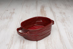 Red Rounded Rectangular Deep Dish on White Wooden Panel Royalty Free Stock Photography