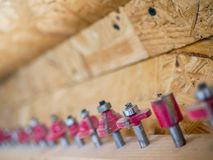 Red router bits close up shot, shallow depth of field. Copy space royalty free stock photography
