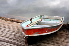 Red row boat on dock Royalty Free Stock Images