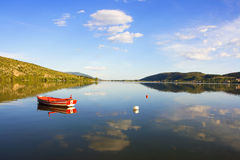 Red Rowing boat in lake. With blue sky Royalty Free Stock Images