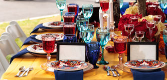Red and royal blue table setting. To celebrate dia de los muertos in October Stock Photography