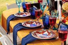 Red and royal blue table setting Royalty Free Stock Image