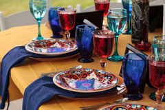 Red and royal blue table setting. To celebrate dia de los muertos in October Royalty Free Stock Image