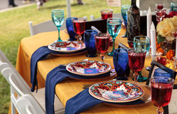 Red and royal blue table setting Stock Photo