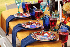 Red and royal blue table setting. To celebrate dia de los muertos in October Royalty Free Stock Photo