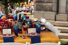 Red and royal blue table setting Stock Photos