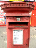 A red Royal Mail post box Stock Photography