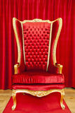 Red royal throne. And red curtain behind Stock Images