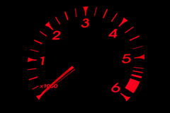 Red RPM Dial. Red light RPM dial, part of car dashboard Stock Images