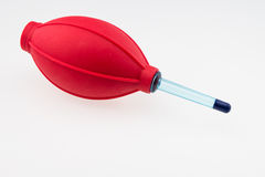 Red rubber air blower pump dust cleaner Royalty Free Stock Photos