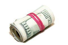 Red rubber band. Roll of money wrapped with a red elastic laying on side isolated Stock Photo
