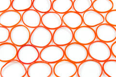 Red rubber band. In pattern on white background Stock Images