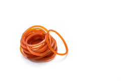 Red Rubber Band on white Royalty Free Stock Photo