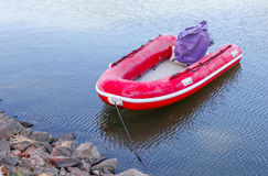 Red Rubber boat at the waterside. Red rubber inflatable boat was tightened at the waterside Stock Photography