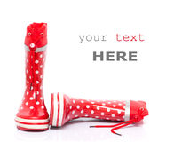 Red rubber boots. For kids isolated on white background (with space for text Royalty Free Stock Photo