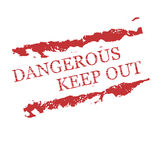 Red rubber stamps Dangerous, Keep out. To warn everyone to Keep out Royalty Free Stock Photo