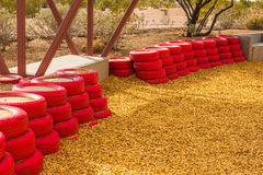Red Rubber Tires Used As Bumpers For Small Children at Desert Pl Royalty Free Stock Images