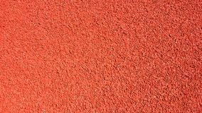 Red rubberized coating for sporting street Jogging tracks. Red rubberized coating for sporting street Jogging track at stadium, view from above Royalty Free Stock Photo
