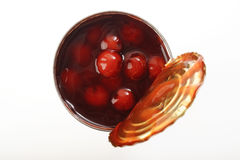 Red ruby cherry in cans for topping cake Stock Images