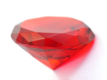 Red ruby gemstone. Transparent red round gemstone on white background royalty free stock photos