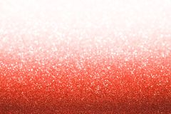 Red ruby glitter background. Sparkle texture. Abstract gradient twinkle background blurred for New Years or Christmas holiday royalty free stock photography