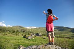 Red rucksack woman pointing Gredos mountain Stock Photos