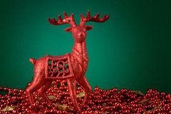 Red rudolf and pearls Stock Images