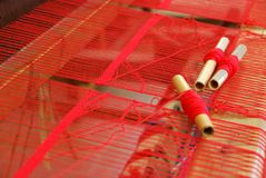 A red rug in the making, old-fashioned style Royalty Free Stock Photography