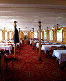 Red rug steam boat dinning room Stock Images