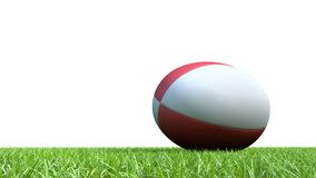 Red rugby ball on grass. 3D red rugby ball on grass V03 Stock Photo