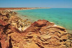 Red Rugged Rocks In Gantheaume Point Stock Image