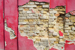 Red ruined plaster wall of bricks Royalty Free Stock Photography