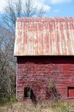 Red Run-Down Barn in Woods stock photos