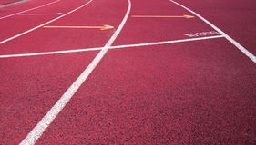 Red running field track Royalty Free Stock Photo