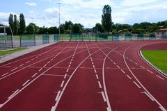 Red running racetrack on the athletic stadium Stock Photo