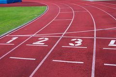 Red running racetrack on the athletic stadium Royalty Free Stock Photography