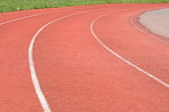 Red running track. Curve on a red running track in arena stock photos