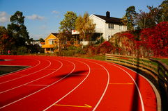 Red running track and sports stadium, Norway Royalty Free Stock Photo