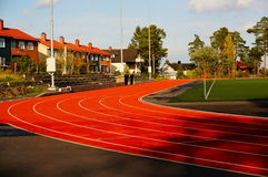 Red running track and sports stadium, Norway Royalty Free Stock Images