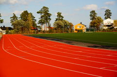 Red running track and sports stadium, Norway Stock Images