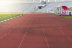Red running track in stadium , Concept of successful Stock Image