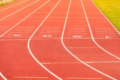 Red running track in stadium. Royalty Free Stock Photo