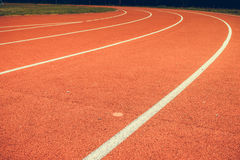 Red running track in stadium. Royalty Free Stock Photo