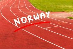 Red running track in stadium. Stock Images