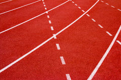 Red running track Synthetic rubber on the athletic stadium. Royalty Free Stock Photography
