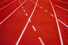 Red running track Synthetic rubber on the athletic stadium. Stock Photos